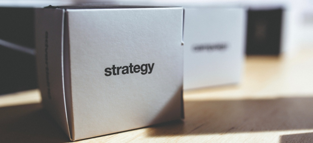"""white paper box with the word """"strategy"""" printed on it"""